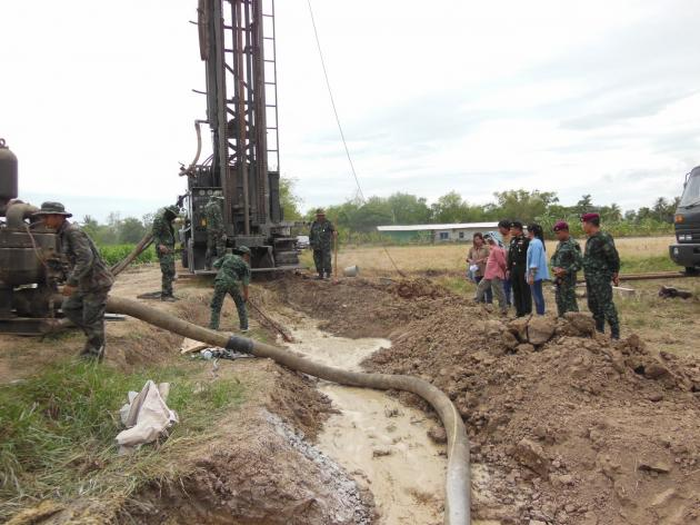 Thai soldiers oversee the construction of new groundwater wells.